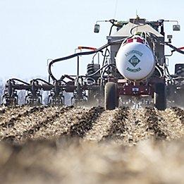 Tractor applying N-Serve® nitrogen stabilizer