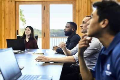 Diverse group sitting around a conference table