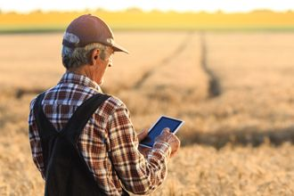 Farmer with a mobile in field