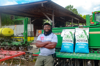 Rep with Pioneer seed bag
