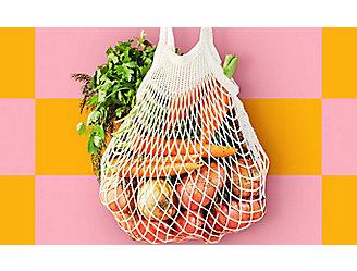 A bag of assorted vegetables hanging.