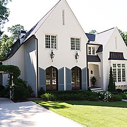 Image of stucco house driveway and lawn