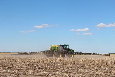 Sprayer in harvested corn