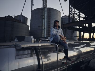 Woman in front of silos
