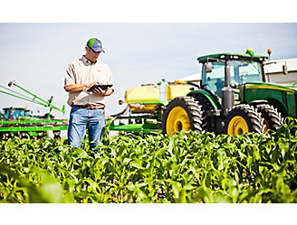 Farmer checking corn field using tablet