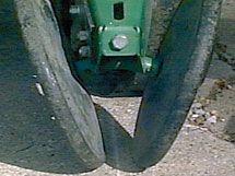 Photo - Closing wheels centered on row.