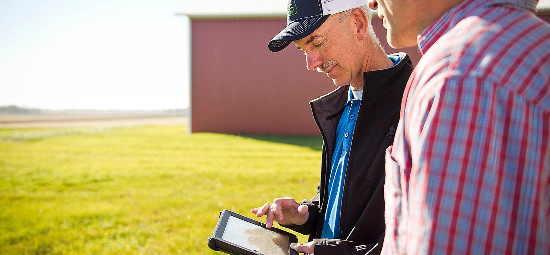 Men looking at tablet