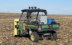 Soil sampling a large field with a mounted hydraulic sampler.