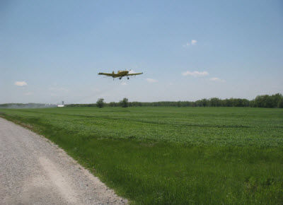 Aerial application of foliar fungicide to wheat field in Missouri.