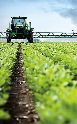 Crop sprayer in soybean field