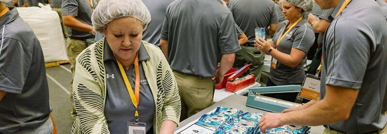 Corteva workers assembling packages
