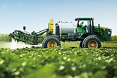 Image of a cotton field with herbicide being applied.