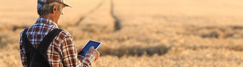 Farmer on mobile in field