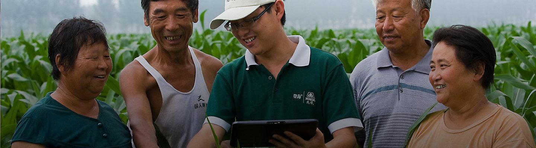 Representative in field with farmers