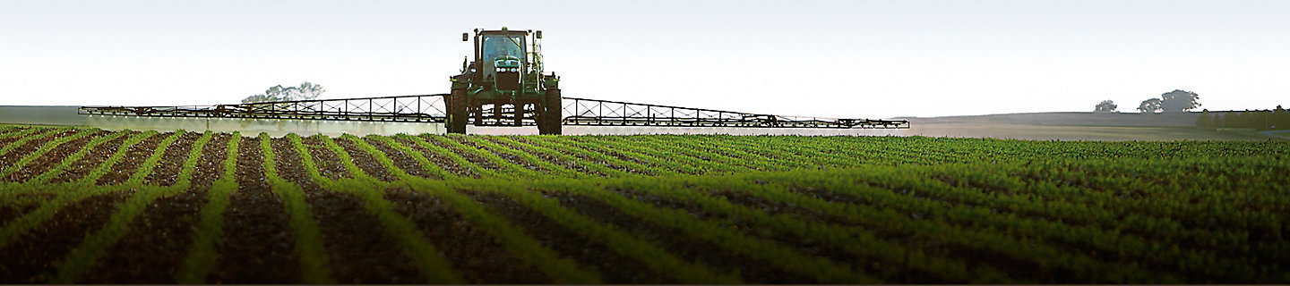 Image of soybean field with application tractor