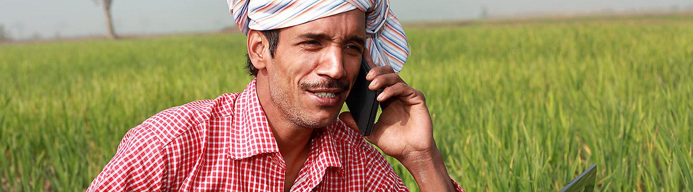 famrer mobile in hand