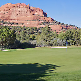 Image of golf course at base of mountains