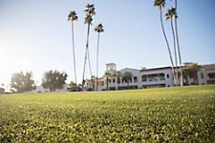 Image of a golf course with a clubhouse in the background