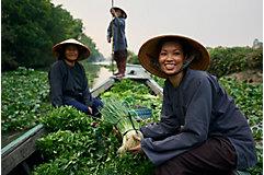 Women farmers showcasing their crops