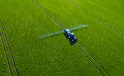 Image of tractor spraying field