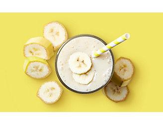 Banana Milkshake on Yellow Background