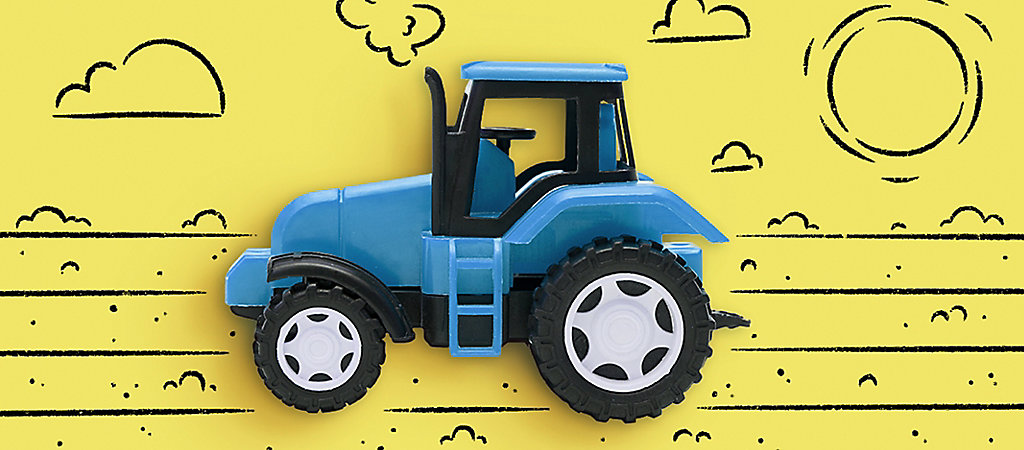 A Toy Tractor on an Illustrated Farm Background