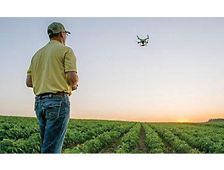 farmer-flying-drone-over-soybean-field
