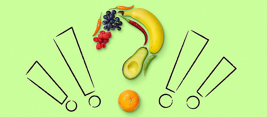 Question mark made of various fruits with four exclamation marks surrounding the fruit question mark.