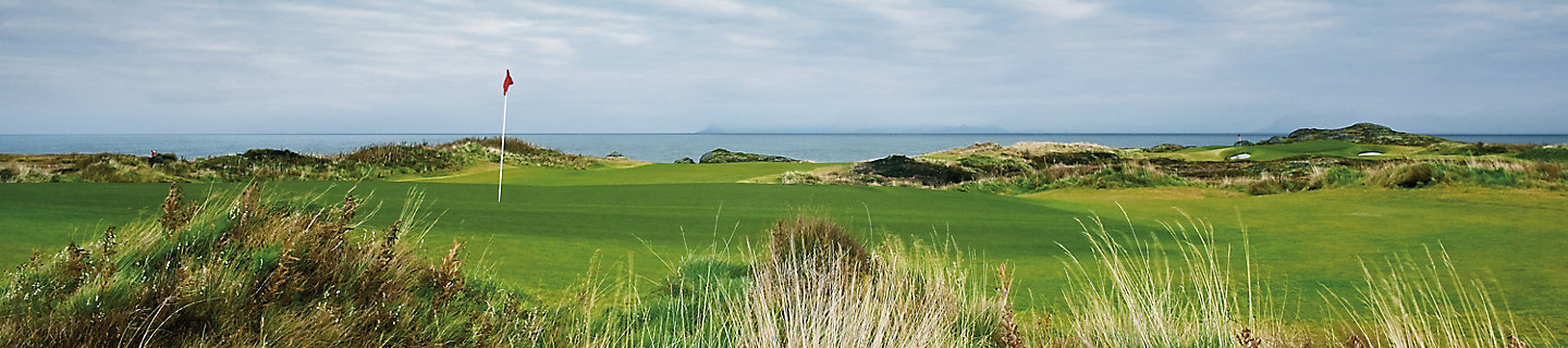 Image of golf course rough and greens by the ocean