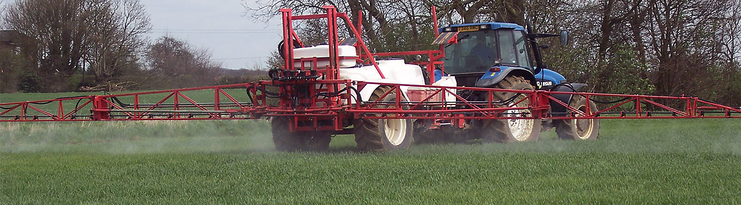 sprayer in wheat field
