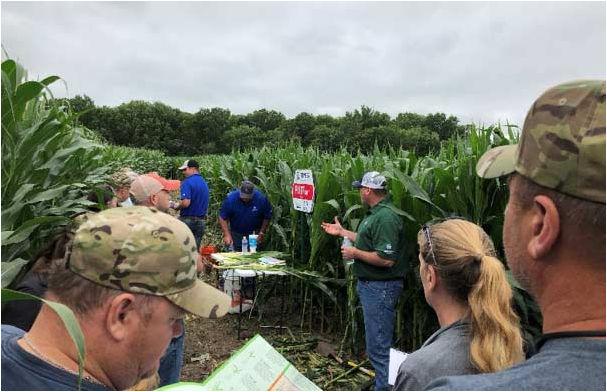 Pioneer Field Agronomist John Heimerman sharing agronomic management.